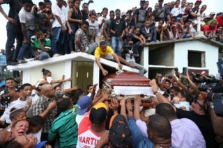 The  casket of St. Louis Cardinals outfielder Oscar Taveras is lifted and  pushed into a mausoleum. Thousands turned out in Sosua, Dominican  Republic, as Taveras was laid to rest on Tuesday.Chris Lee/St. Louis Post-Dispatch