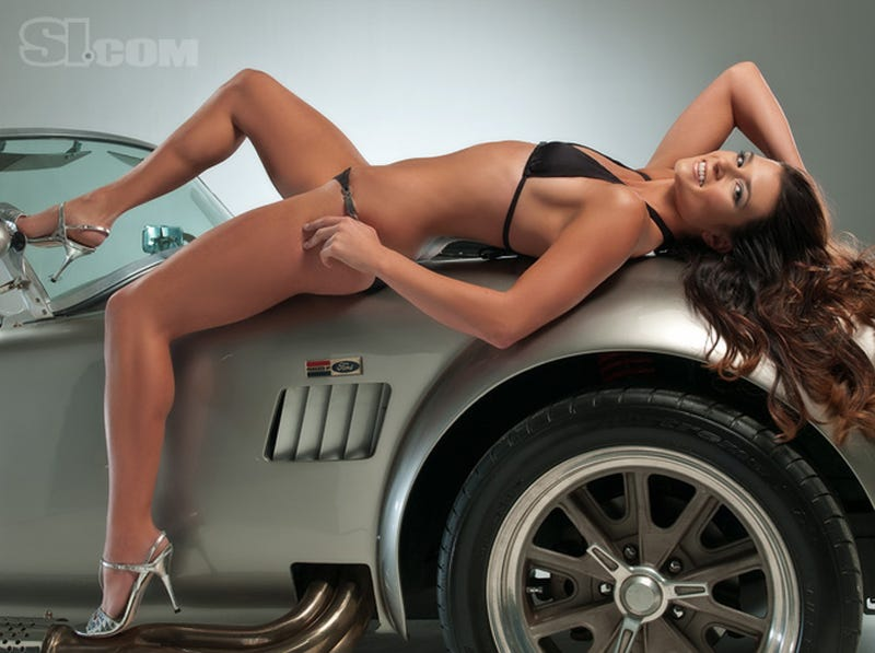 Illustration for article titled Danica Patrick Straddles A Cobra In New SI Swimsuit Issue