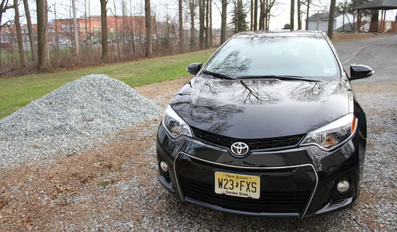 Pictured: a Corolla in front of its natural habitat, a high school parking lot.
