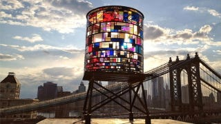 Illustration for article titled Stained-Plexiglas Watertower Illuminates the Brooklyn Skyline in Dazzling Color