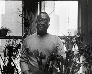 Norman Lewis in the studioBudd Estate of Norman W. Lewis; courtesy of Michael Rosenfeld Gallery, New York, N.Y.