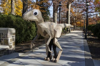 Illustration for article titled Great Cosplay Choices: Googly-Eyed Cardboard Dinosaur