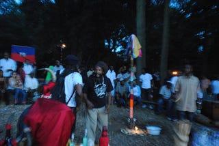 Deenps Bazile, center, leads a Vodou ceremony.