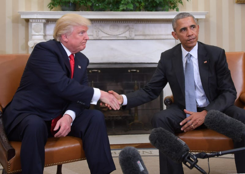 President-elect Donald Trump and President Barack Obama shake hands during a  transition-planning meeting in the Oval Office at the White House in Washington, D.C., on Nov. 10, 2016.JIM WATSON/AFP/Getty Images