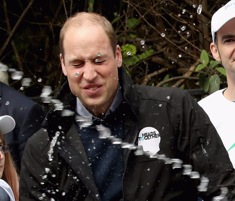 Illustration for article titled Rude London Marathoner Shoots Prince William With Water While Kate Middleton Smirks