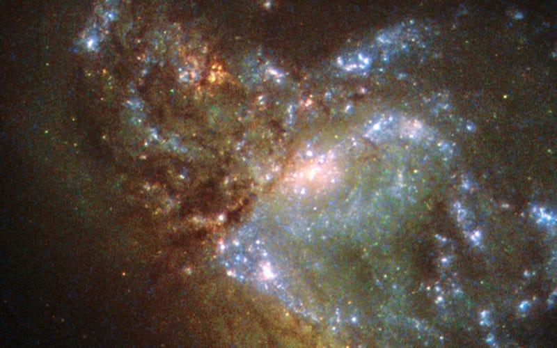 Illustration for article titled Este es el aspecto de dos galaxias que se fusionan, visto con los ojos del Hubble
