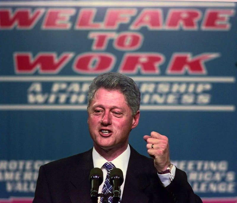 Then-President Bill Clinton clinches his fist during a speech on welfare reform at Vanderbilt University Medical Center in Nashville, Tenn., on Oct. 27, 1996.PAUL J. RICHARDS/AFP/Getty Images