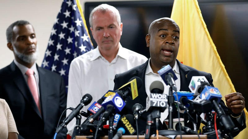 Newark, N.J., Mayor Ras Baraka speaks about the city's ongoing water crisis Aug. 14, 2019, in Newark. At left is Kareem Adeem, acting director of Water and Sewer Utilities in Newark and New Jersey Gov. Phil Murphy.
