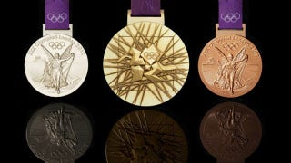 Illustration for article titled The London Olympic Medals Are Here, And They've Got That Weird Lisa Simpson Blowjob Logo