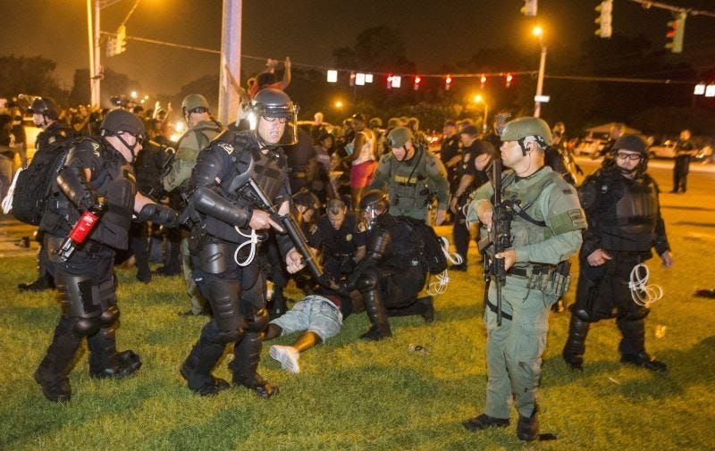 Baton Rouge, La., police rush a crowd of protesters and start making arrests July 9, 2016. The protests were a result of the fatal police shooting of Alton Sterling outside a convenience store July 5, 2016.