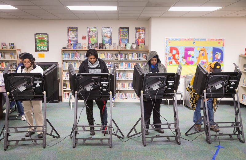 Residents cast their votes at a polling place on November 4, 2014 near Ferguson, Missouri. In last Aprils election only 1,484 of Ferguson's 12,096 registered voters cast ballots