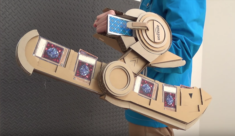 Illustration for article titled Yu-Gi-Oh! GX Duel Disk Remade In Cardboard
