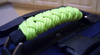 Illustration for article titled Wrap Your Luggage Handle in Neon Cord for Easy Identification and Comfort