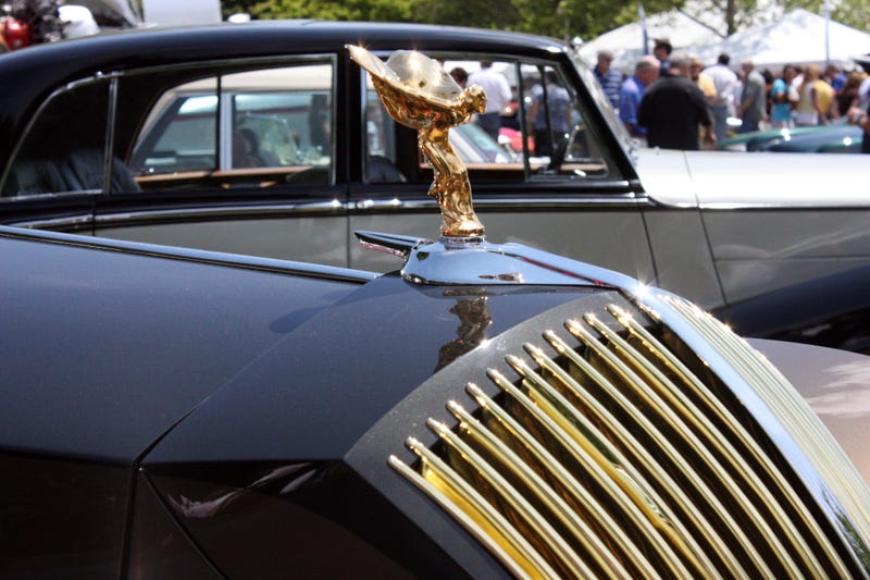 A solid gold spirit of ecstasy perched on top of an outrageous custom-bodied Roller.