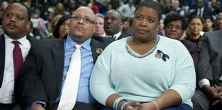 Nathaniel and Cleopatra Pendleton listen to President Obama in Chicago. (Saul Loeb/AFP/Getty Images)