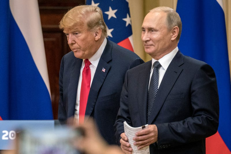 President Donald Trump (L) and Russian President Vladimir Putin arrive to waiting media during a joint press conference after their summit on July 16, 2018 in Helsinki, Finland.