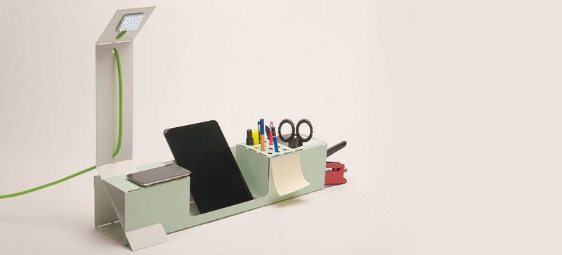 Illustration for article titled This Desk Tidy Folds Into Shape From a Sheet of Laser-Cut Steel