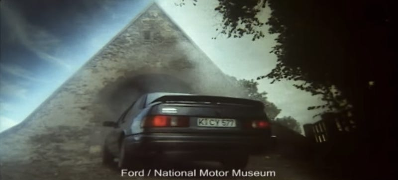 Illustration for article titled Want A Ford Sierra Cosworth? Just Get A Mysterious Glowing Pyramid