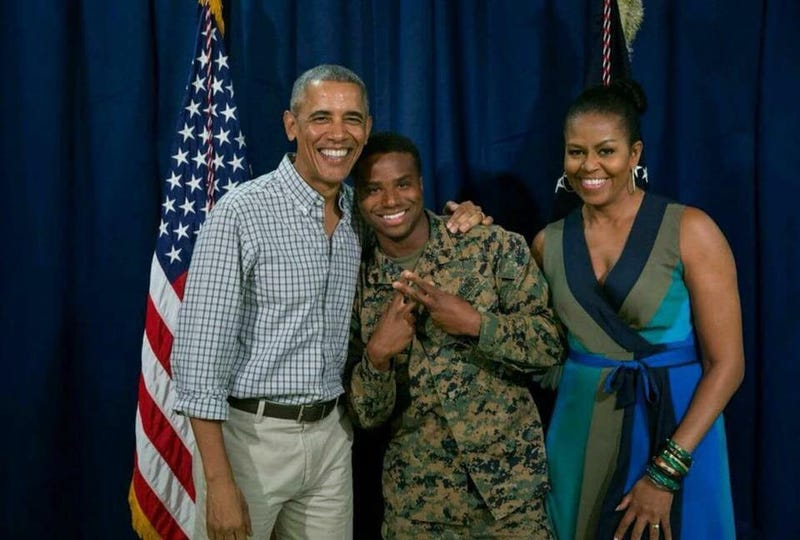 Sgt. William Brown, shown here with then-President Barack Obama and first lady  Michelle Obama  during the Obamas' visit to Marine Corps Base Hawaii (Hawaii News Now/the Daily Mail via friends of William Brown)