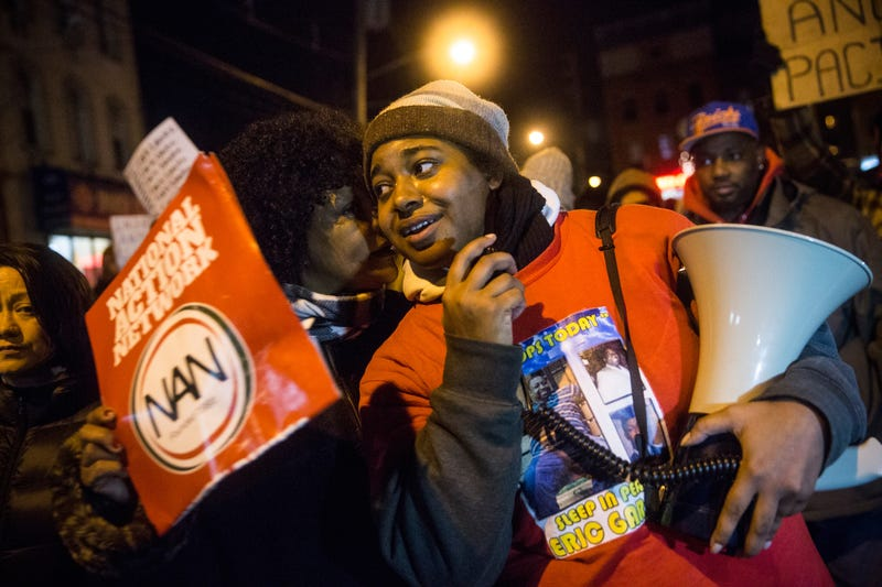 Erica Garner, daughter of Eric Garner, leads a march of people protesting a Staten Island, N.Y., grand jury's decision not to indict a police officer involved in the choke hold death of Eric Garner in July, on Dec. 11, 2014. (Andrew Burton/Getty Images)