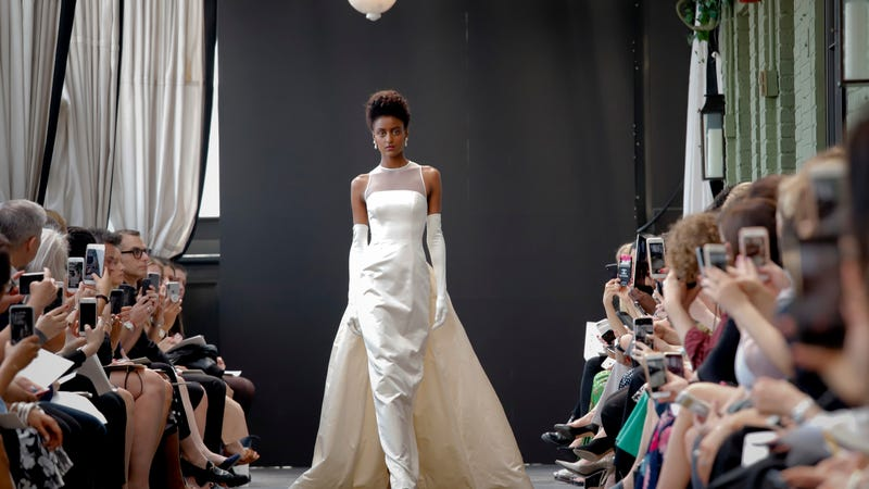 A model closes out Amsale's Bridal Week show in the first dress Amsale ever designed, from 1990.