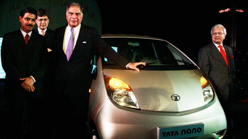 MUMBAI, INDIA - MARCH 23: Ratan Naval Tata Chairman of Tata Group (C) attends the launch of the Tata Nano on March 23, 2009 in Mumbai, India. Tata Motors today launched the world's cheapest car which will initially go on sale in India and cost roughly 2000 USD. (Photo by Ritam Banerjee/Getty Images)