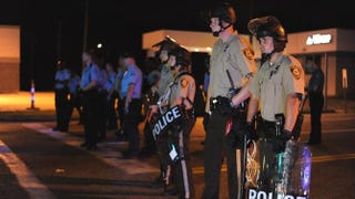Law-enforcement officers on duty during a protest on West Florissant Avenue in Ferguson, Mo., on Aug. 18, 2014Michael B. Thomas/AFP/Getty Images