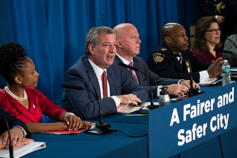 Community organizer Monique Waterman, New York City Mayor Bill de Blasio, New York City Police Commissioner James O'Neill and NYPD Chief of Patrol Rodney Harrison hold a press conference to announce a new policy that they say will reduce unnecessary marijuana arrests on June 19, 2018, in New York City.