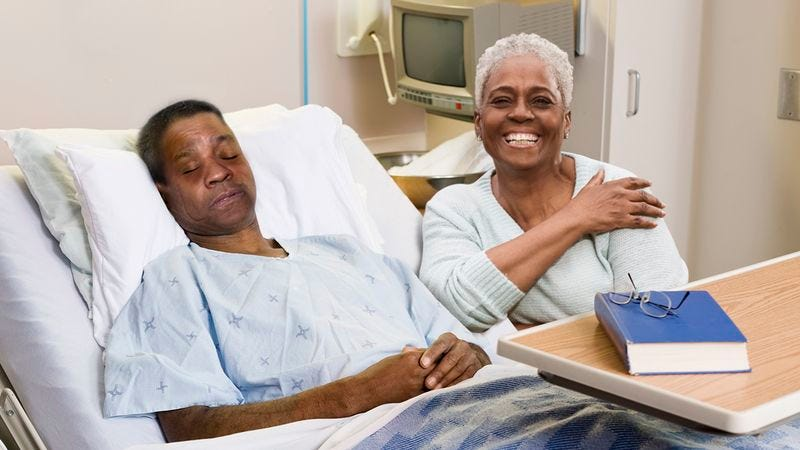 A woman with her comatose husband, who looks like Denzel Washington, in the hospital.