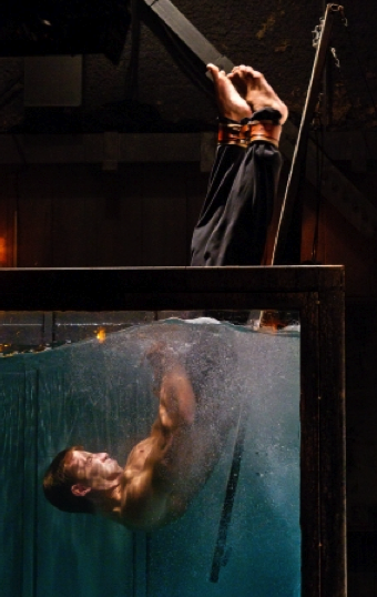 Illustration for article titled Smallville gives us Saul Tigh as Deathstroke (and erotic waterboarding)