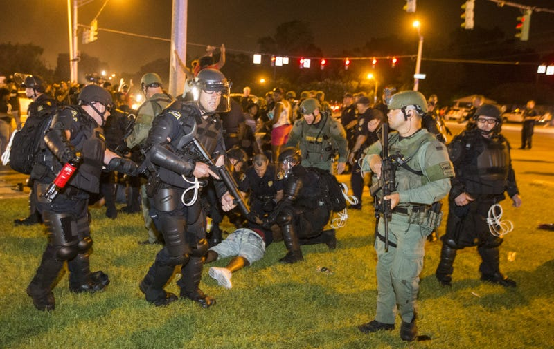 Police rush a crowd of protesters and start making arrests July 9, 2016, in Baton Rouge, La.Mark Wallheiser/Getty Images