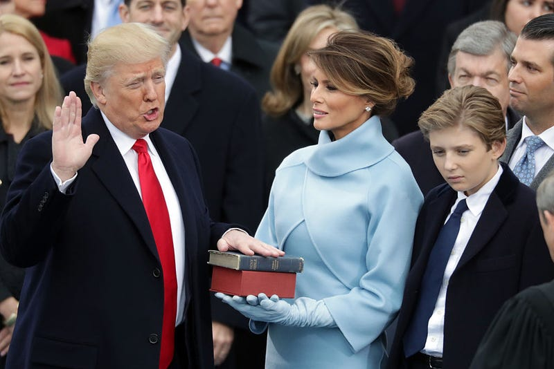 Donald Trump takes the oath of office as his wife, Melania, holds the Bible and their son, Barron, looks on Jan. 20, 2017, in Washington, D.C. (Chip Somodevilla/Getty Images)
