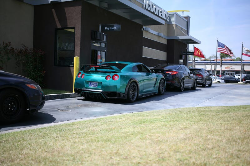 Illustration for article titled Here's an R35 GTR in a McDonalds drive-through