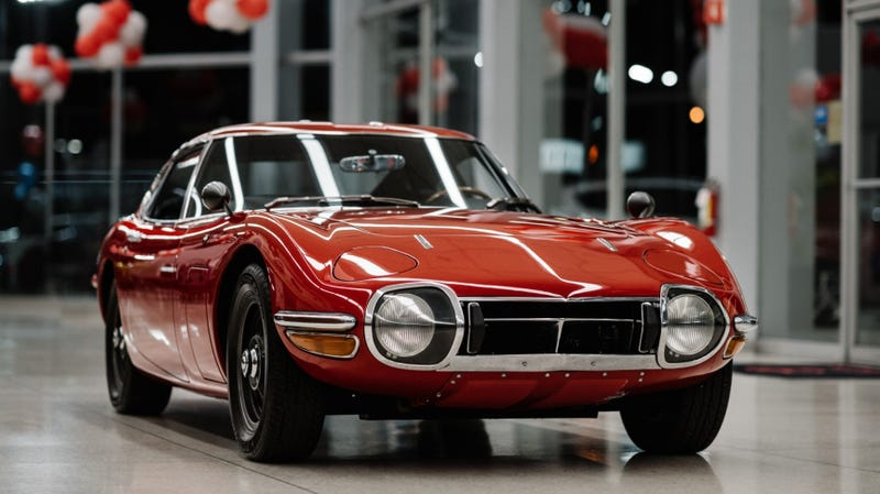 Illustration for article titled Hey, Let's Rob Some Banks To Buy This Perfect Left-Hand-Drive Toyota 2000GT