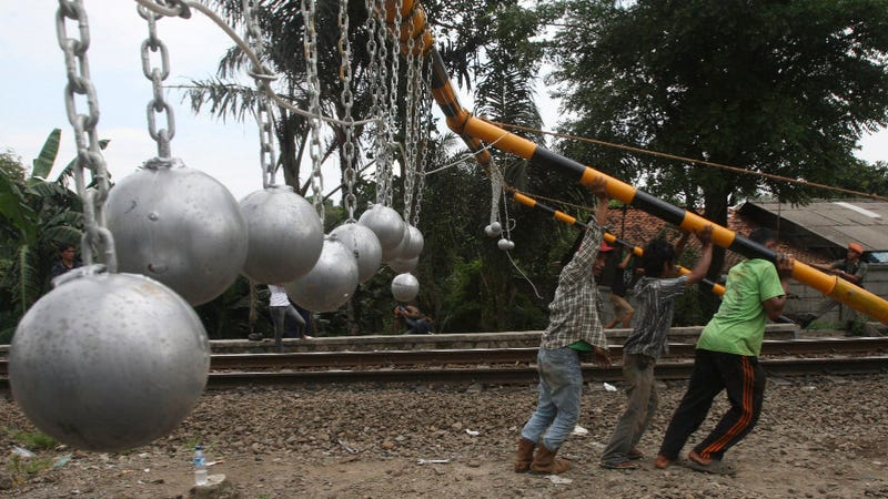 """Illustration for article titled Grapefruit-Sized """"Goal Balls"""" Aim to Clear Indonesian Train Roofs of Ruffians"""