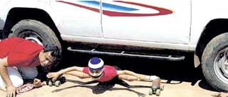 Illustration for article titled This Kid Totally Rules: Sets Automotive Roller-Skate Limbo Record!