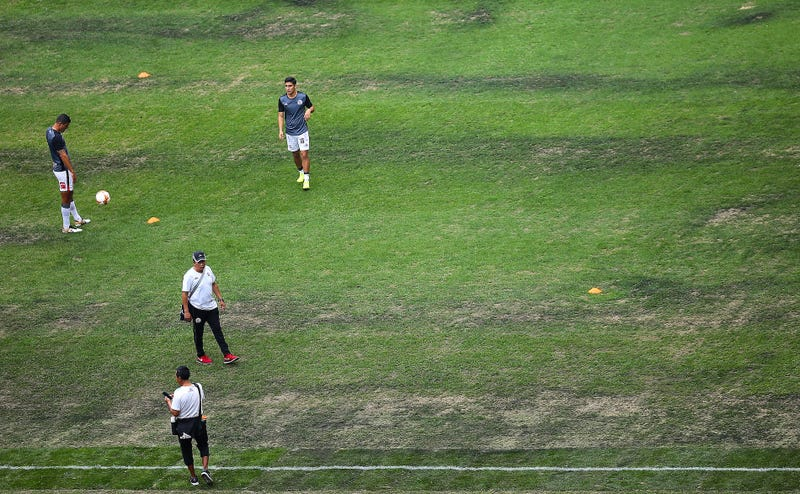 Liga MX players warm up on the field at Estado Azteca on Nov. 10, 2018.