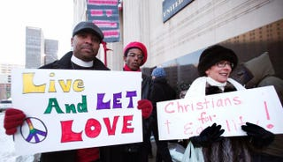 Supporters of same-sex marriage in front of the federal courthouse in Detroit March 3, 2014Bill Pugliano/Getty Images