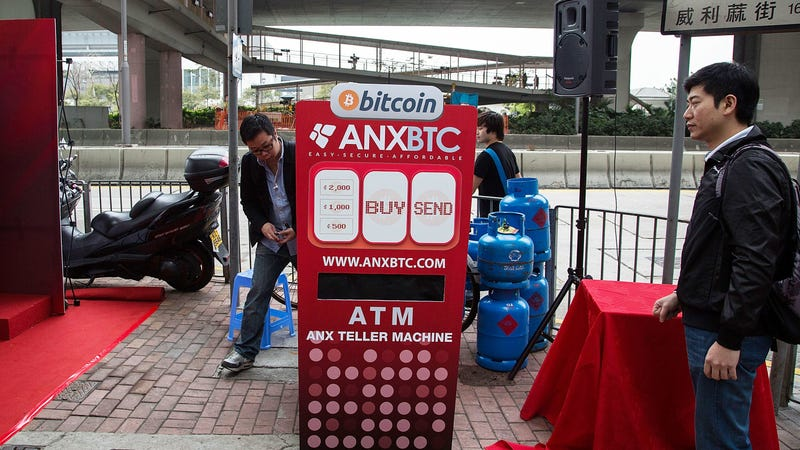 Locals attend the opening of the first bitcoin retail store in Hong Kong in 2014. Photo: Getty