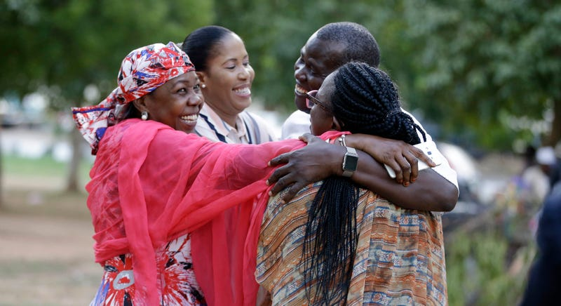 Photo: AP (Pictured: 'Bring Back Our Girls' campaigners celebrate release of girls and young women from Boko Haram.)