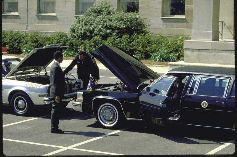 Illustration for article titled President Reagan's limo gives a police car a jump start. New Year's Eve 1984