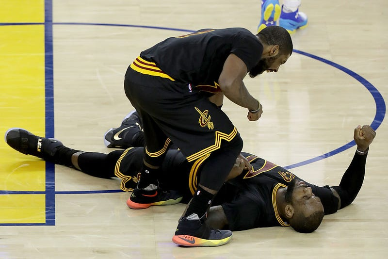 Kyrie Irving (standing) and LeBron James of the Cleveland Cavaliers  in Game 5 of the 2016 NBA Finals at Oracle Arena on June 13, 2016, in Oakland, Calif. (Ronald Martinez/Getty Images)