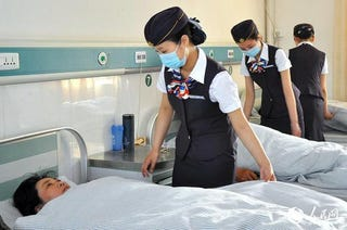 Illustration for article titled Nurses Cosplay as Flight Attendants at a Chinese Hospital