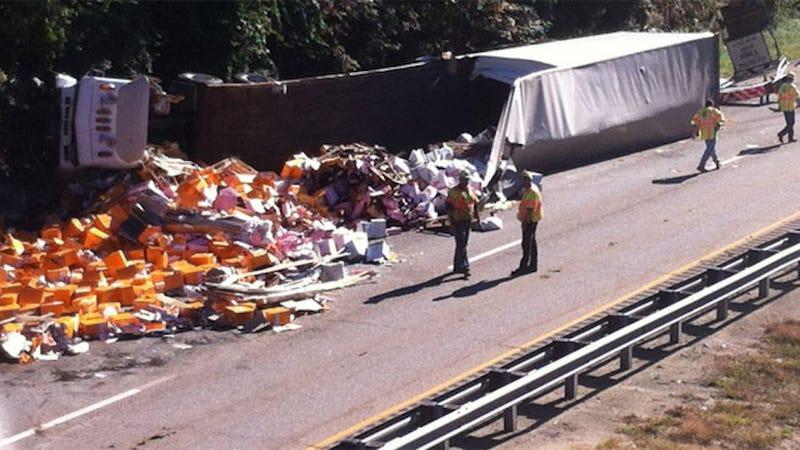 Illustration for article titled 18-Wheeler Crashes, Spills Hundreds of Bottles of Champagne on Highway