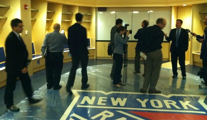 Illustration for article titled Please Don't Step On The Enormous Logo In The Rangers' Locker Room, Unless They Throw A Rug On Top