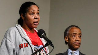 Eric Garner's widow Esaw Garner speaks at a press conference next to the Rev. Al Sharpton at the National Action Network in Harlem on Dec. 6, 2014. Kena Betancur/Getty Images