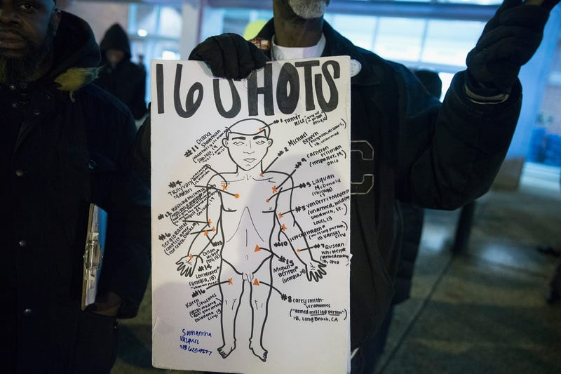 Demonstrators protest in front of the City of Chicago Public Safety Headquarters over the killing of Laquan McDonald on December 1, 2015