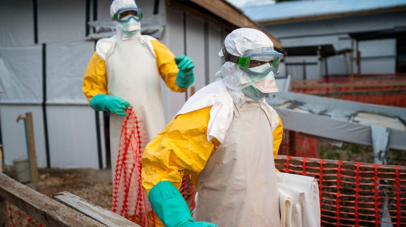 In this photograph taken Saturday July 13, 2019, health workers wearing protective suits take their shift at a treatment center in Beni, Congo DRC.