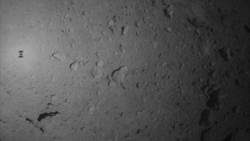 An image taken of the Ryugu asteroid during the recent, unsuccessful attempt to drop a marker on the surface. The shadow of the Hayabusa2 space probe can been seen at left.
