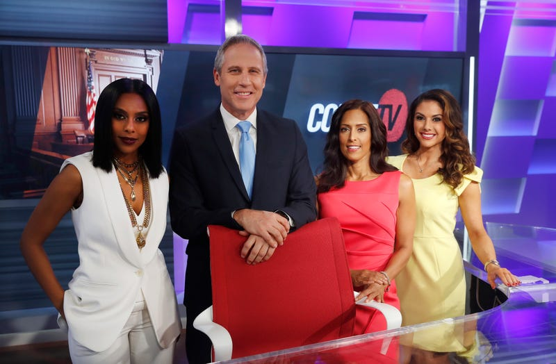 Court TV's Yodit Tewolde, from left, Vinnie Politan, Seema Iyer and Julie Grant pose at the Court TV anchor desk, on May 2, 2019 in Atlanta.